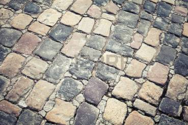 37218763-old-stone-road-pavement-background-texture-vintage-toned-photo-with-retro-filter-effect